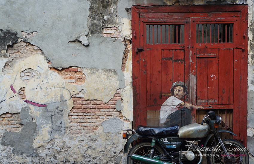 """Boy on a Bike"" Mural, Ah Quee Street, George Town, Penang by Ernest Zacharevic"