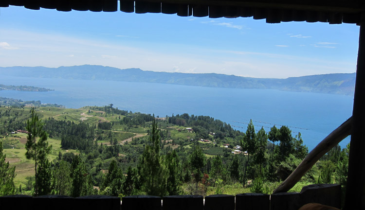 Behold, Lake Toba view from the top of a hill. Rent a bike to explore the small town and came to a small 'warong' uphill with this scenic view.