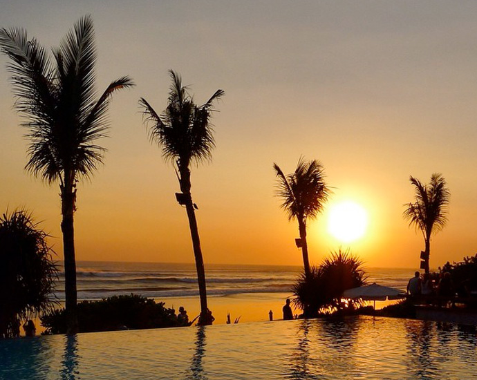 Infinity pool overlooking a golden sunset at Potato Head Beach Club, Bali