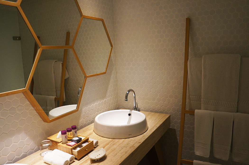 The white hexagonal themed bathroom area
